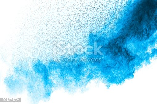 918139336istockphoto Abstract blue dust explosion on  white background. Abstract blue powder splattered on white background. Freeze motion of blue powder splash. 901574724