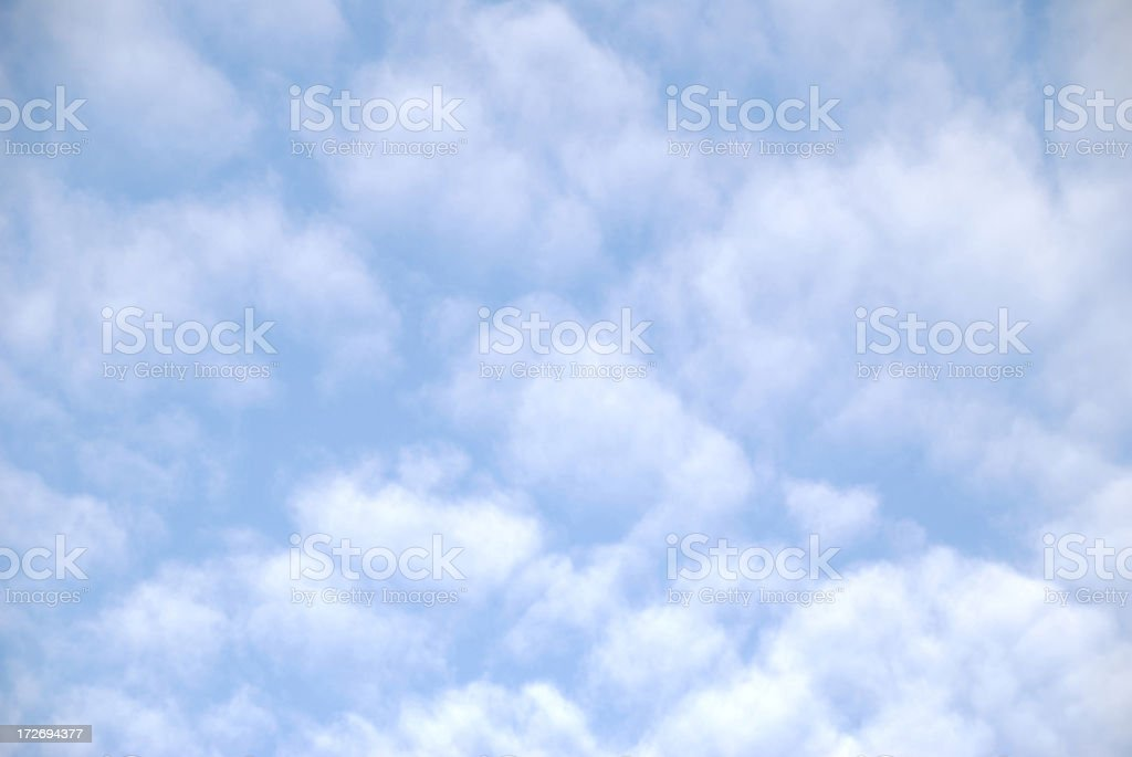 Abstract Blue Sky with Puffy Pink Cloud Background royalty-free stock photo