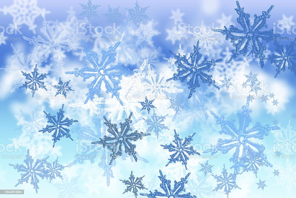 abstract blue snowflakes background royalty-free stock photo