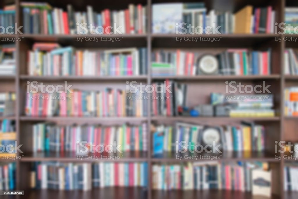 Abstract blur and defocused bookshelf in library interior for...