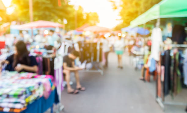 abstract blur background of people shopping at market fair, made - marktkraam stockfoto's en -beelden