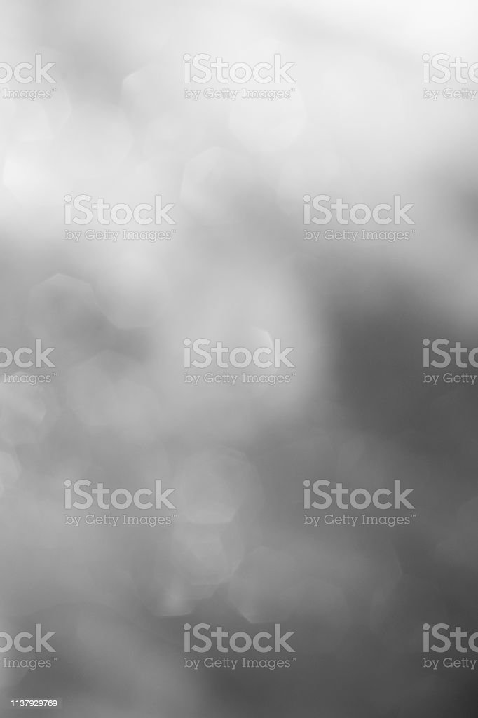 blurred background black and white. blur wallpaper with light dots -...