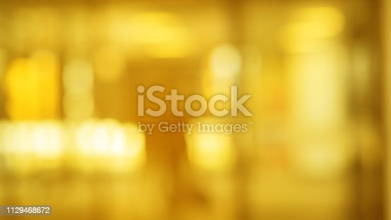 abstract blur beautiful gold color background with bokeh light party for design concept