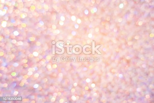 1068830592istockphoto abstract blur beautiful pink or rose gold color background with bokeh light party for merry christmas, happy new year celebrate and valentines day concept 1078350046