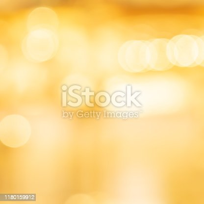 892646638 istock photo abstract blur beautiful soft bright gold color square background with circle bokeh light and shinning for christmas festival and happy new year season collection design as banner concept 1180159912