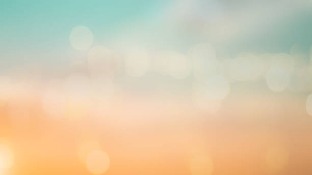 abstract blur beautiful sunrise sky background in the summer season vacation with double exposure bokeh for design concept - d'atmosfera foto e immagini stock