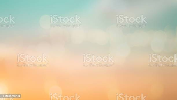 Photo of abstract blur beautiful sunrise sky background in the summer season vacation with double exposure bokeh for design concept