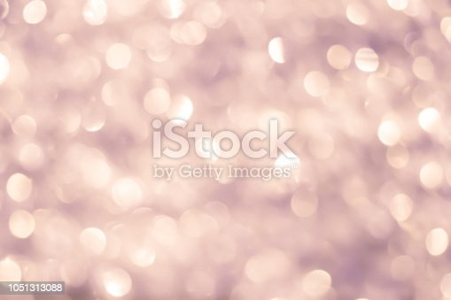 istock abstract blur beautiful tan color background with bokeh light background  for luxury style ornament 1051313088
