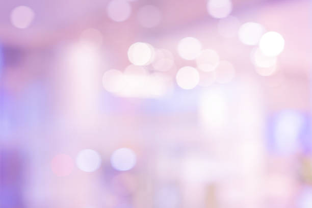 abstract blur beautiful violet colorful with luxury bokeh bulbs light panoramic background in gala event  for design as banner template concept - colore lavanda foto e immagini stock