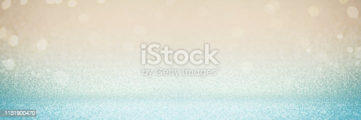 istock Abstract blur blue gold glitter christmas event celebration card design wide screen background concept - shiny teal light dust sparkle festive decoration effect, smooth holiday texture golden wallpaper, happy new year 2020 1131900470
