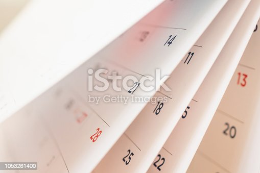 istock Abstract blur calendar page flipping sheet close up background 1053261400