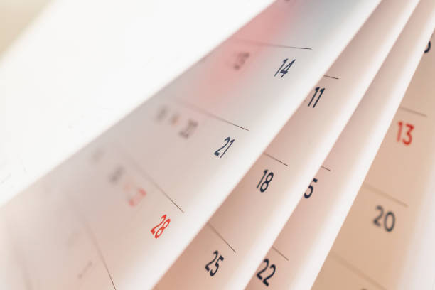 abstract blur calendar page flipping sheet close up background - calendar imagens e fotografias de stock