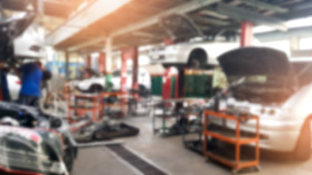 Abstract blur car technicians repairing cars in workshop service station background.Auto repair shop in bokeh, defocused background Abstract blur car technicians repairing cars in workshop service station background.Auto repair shop in bokeh, defocused background repairman stock pictures, royalty-free photos & images