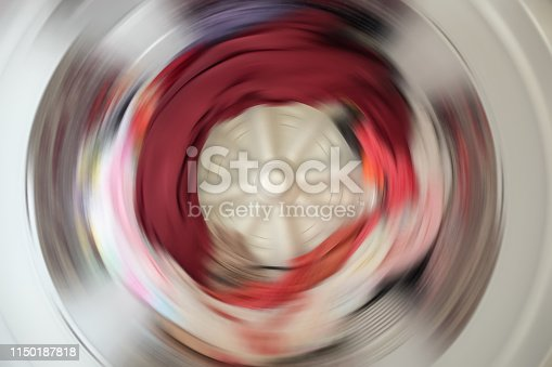 istock Abstract blur Clothes in washing machine during work 1150187818