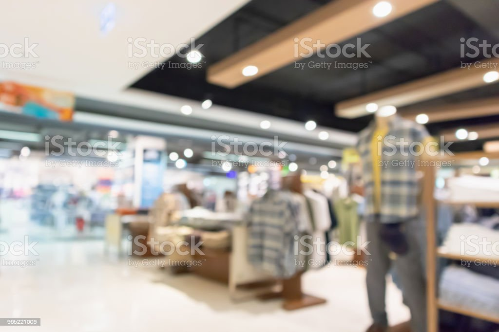 Abstract blur clothing boutique display interior of shopping mall background royalty-free stock photo