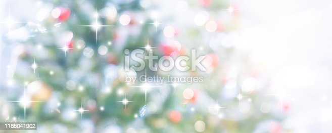 istock abstract blur decorated christmas ornament pine tree in home interior background with blinking star and snowfall effect for show,ads,design product on display concept in merry xmas and happy new year season concept 1185041902