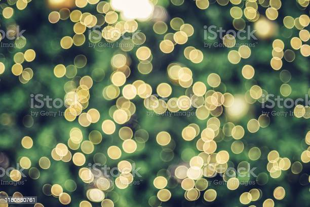 Photo of Abstract blur decoration ball and light string on christmas tree with bokeh light background.winter holiday seasonal