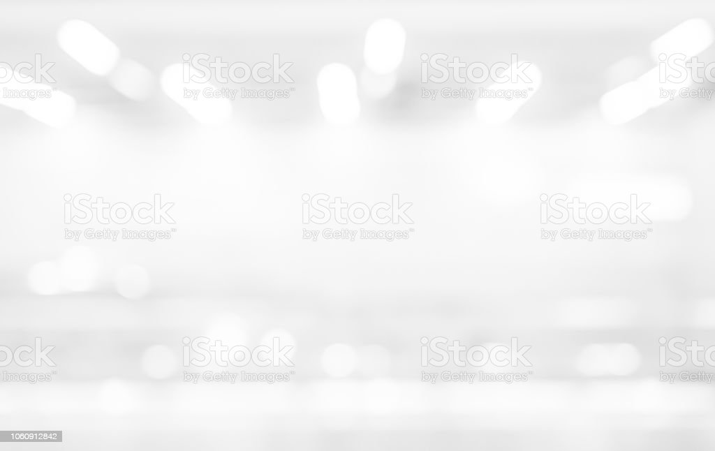 abstract blur exposure of white silver color background with bokeh light for design element concept