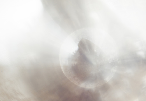 1060912842 istock photo Abstract blur exposure of white silver color background with bokeh light for design element concept 1198448373