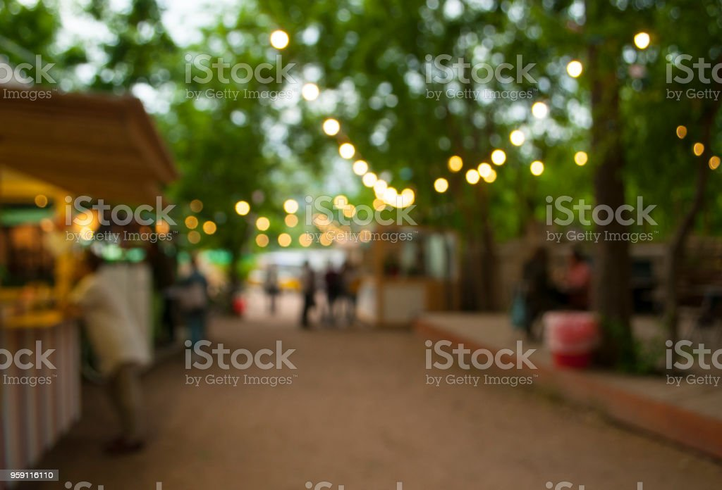 Abstract blur festival in the city park bokeh background. stock photo