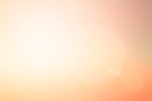 abstract blur glowing orange gold of morning  sky color tone background with white sunshine light effect for design as banner,presentation,ads concept