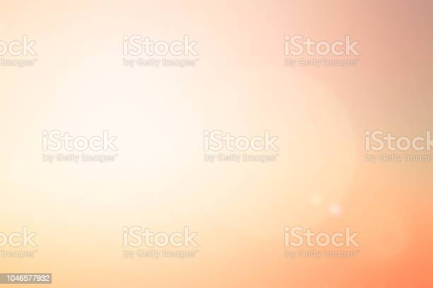 Photo of abstract blur glowing orange gold of morning  sky color tone background with white sunshine light effect for design as banner,presentation,ads concept