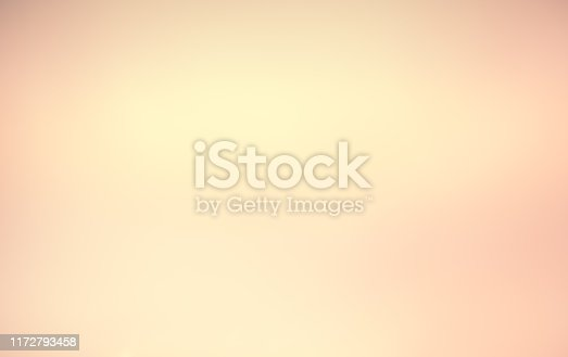 892646638 istock photo Abstract blur glowing orange gold of morning sky color tone background with white sunshine light effect for design as banner,presentation,ads concept 1172793458