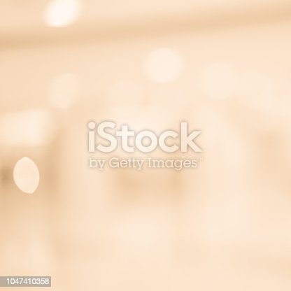 abstract blur glowing tan and pale sepia color in square background with double exposure bokeh light for happy new tear and merry christmas celebration festival design element concept