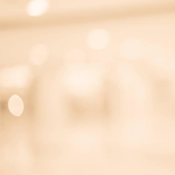 abstract zu verwischen glühende tan und blass sepia farbe im quadratischen hintergrund mit doppelte belichtung bokeh licht für glückliche neue reiß- und frohe weihnachten feiern festival design element-konzept - kupferfarbe stock-fotos und bilder