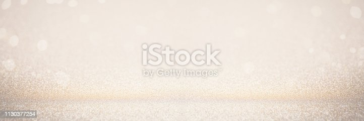 istock Abstract blur gold glitter christmas event celebration card design wide screen background concept - shiny golden light dust sparkle festive decoration effect, smooth holiday texture golden wallpaper, happy new year 2020 1130377254