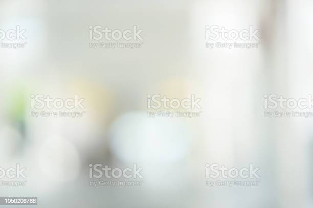Photo of abstract blur grey color gradient background of interior contemporary workplace loft style office for design concept