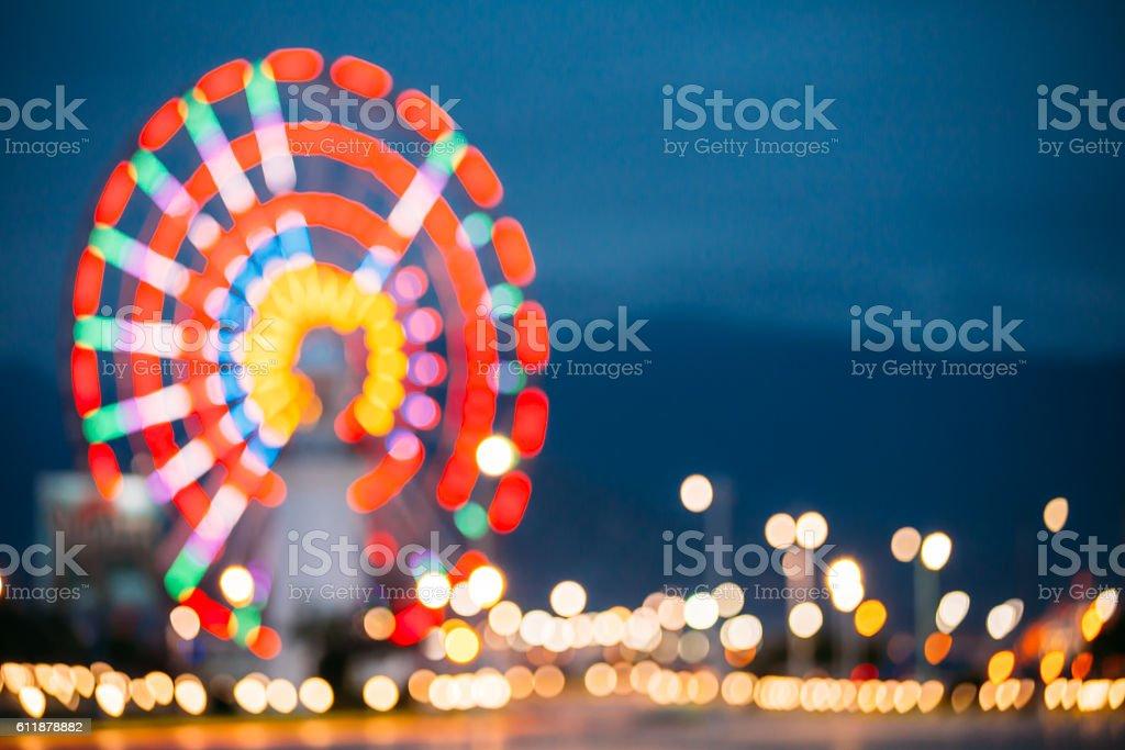 Abstract Blur Image Of Illuminated Ferris Wheel In Amusement Park stock photo