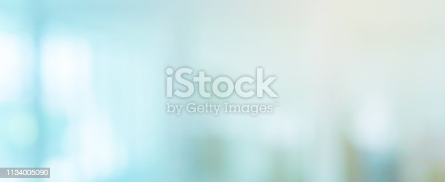 abstract blur inside interior of modern cleaning workplace in blue color in panoramic background with shine light for design