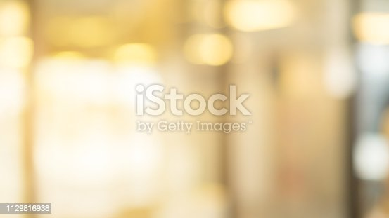 abstract blur inside modern architecture loft cozy interior shopping mall or department store with light bokeh fro design concept