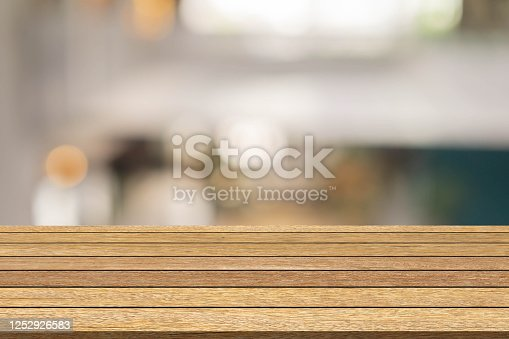 864907996 istock photo abstract blur loft style cafe bar background with vintage wood perspective for show ,promote and advertise content or  product on display 1252926583