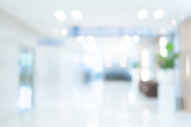 abstract blur luxury hospital corridor. blur clinic interior background with defocused effect. healthcare and medical concept - office background imagens e fotografias de stock