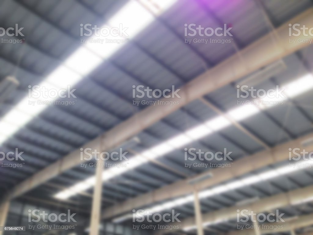 abstract blur :metal sheet , building structure and transparent  roof inside factory royalty-free stock photo