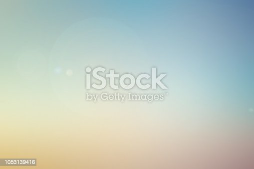 istock abstract blur multi color pastel background of skyline in early morning time with glow flare light effect for design concept 1053139416