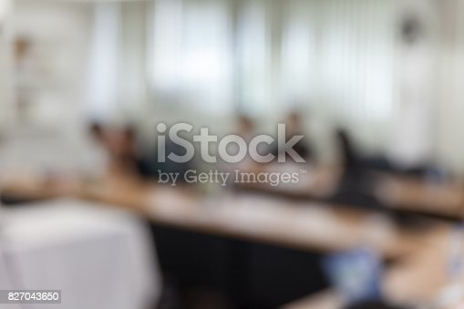 821463698 istock photo abstract blur people in meeting room 827043650