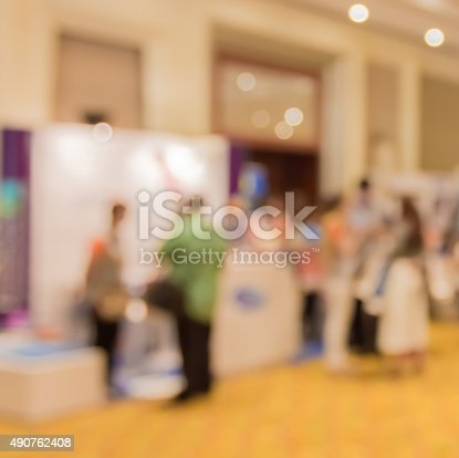 istock Abstract blur people in press conference event room, business co 490762408