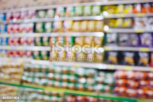 836871040 istock photo Abstract blur potato chips sanck product in supermarket shelves 843051904