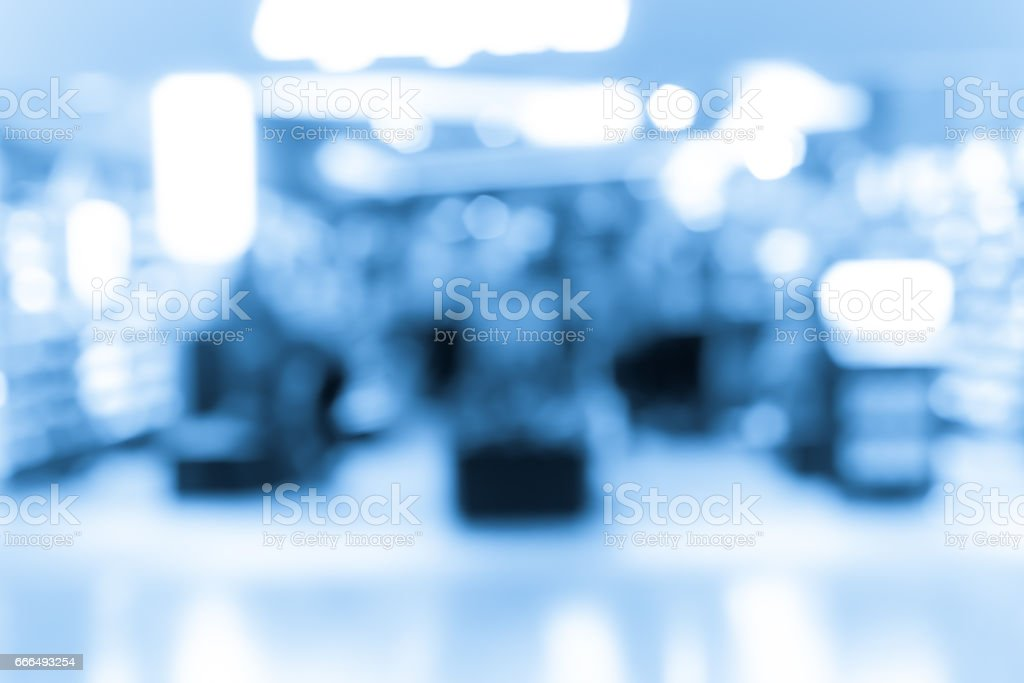 Abstract blur shopping mall interior and retail store for background in blue color stock photo