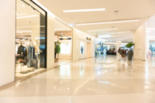 abstract blur shopping mall luxury and derpartment store for background - shopping mall stock photos and pictures
