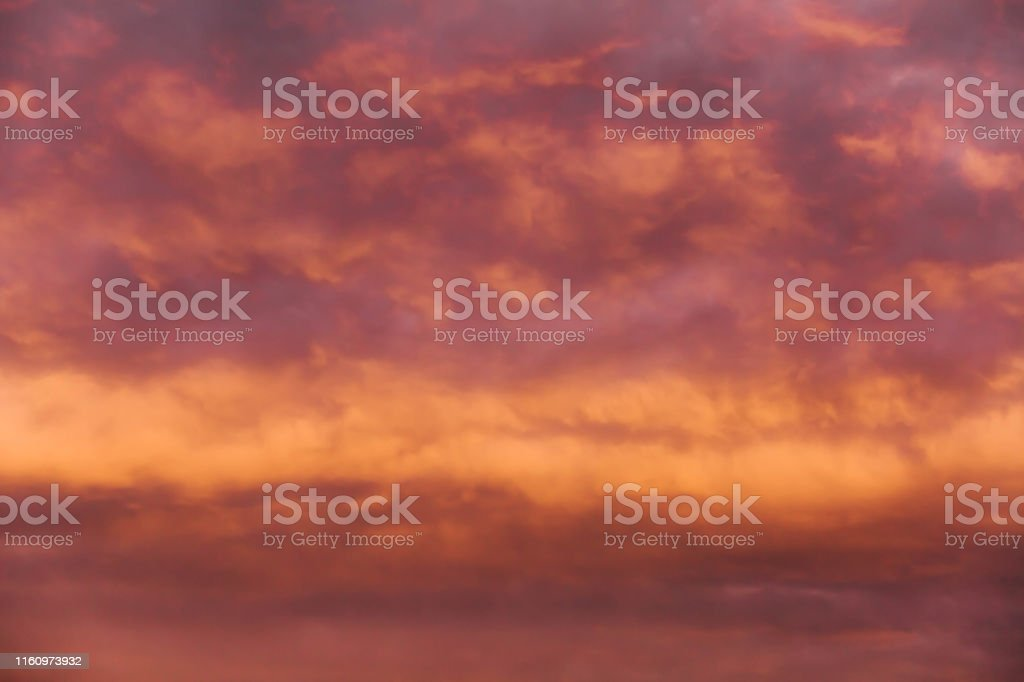 Abstract blur beautiful sunset sky above clouds with dramatic light....