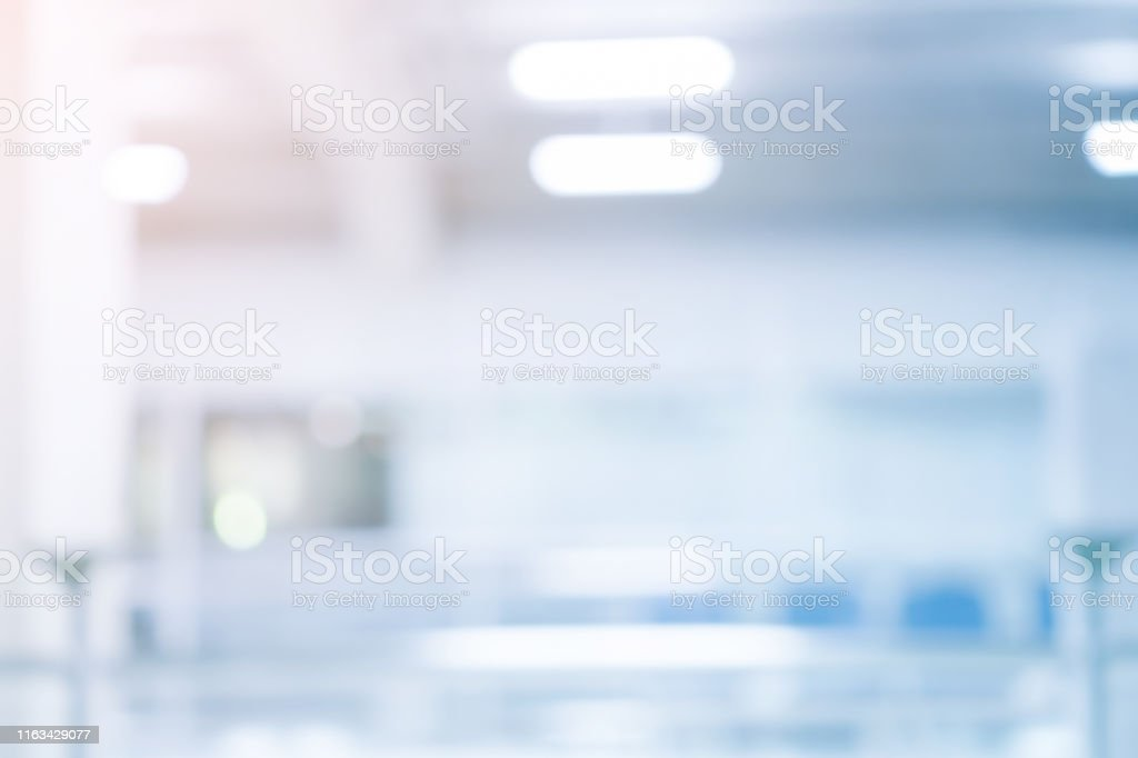 abstract Blur soft focus blauwe kleur interieur van moderne reiniging werkplek achtergrond met oranje glans licht voorontwerp concept - Royalty-free Abstract Stockfoto