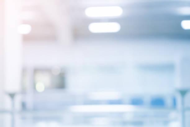 abstrakcyjne rozmycie miękkie ognisko niebieski kolor wnętrze nowoczesnego czyszczenia tła pracy z pomarańczowym blaskiem dla koncepcji projektowej - laboratorium zdjęcia i obrazy z banku zdjęć