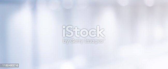 1050778746 istock photo abstract blur soft focus interior of modern  workplace background with shine light for design concept 1150480216