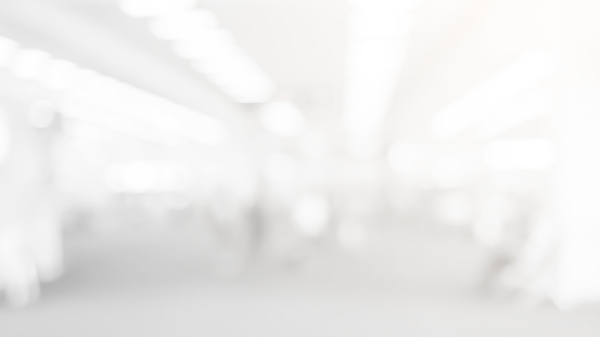 abstract blur soft focus white color interior of modern cleaning workplace background with shine light for design