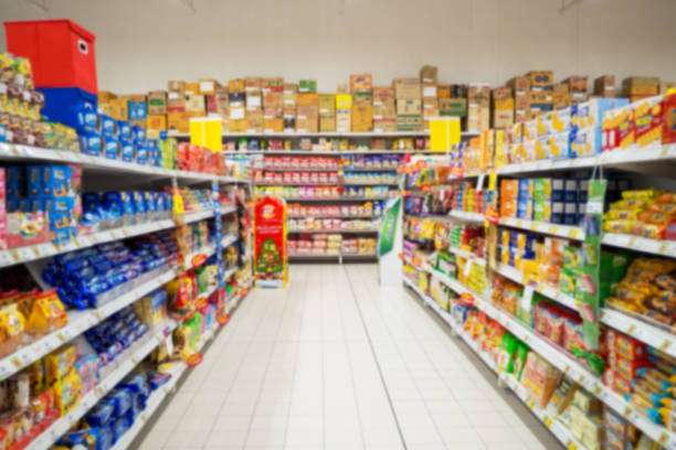 Abstract blur supermarket and retail store in shopping mall for background. stock photo