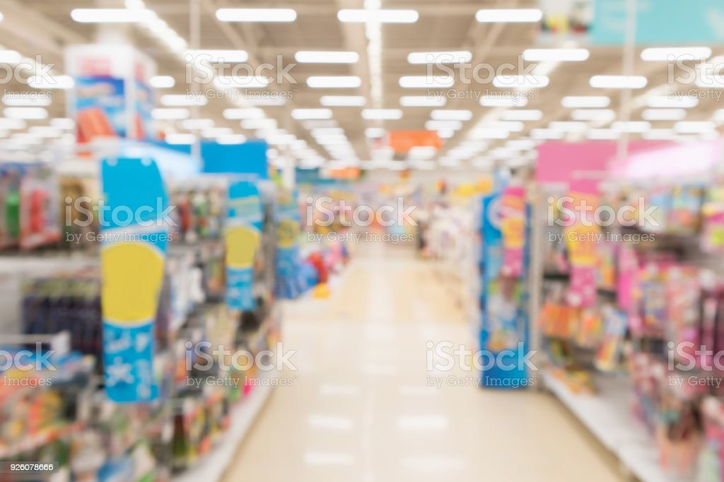 Abstract blur supermarket discount store aisle and product shelves interior defocused background royalty-free stock photo